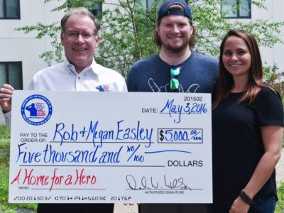Coalition President David Walker presents the Easley's with a check